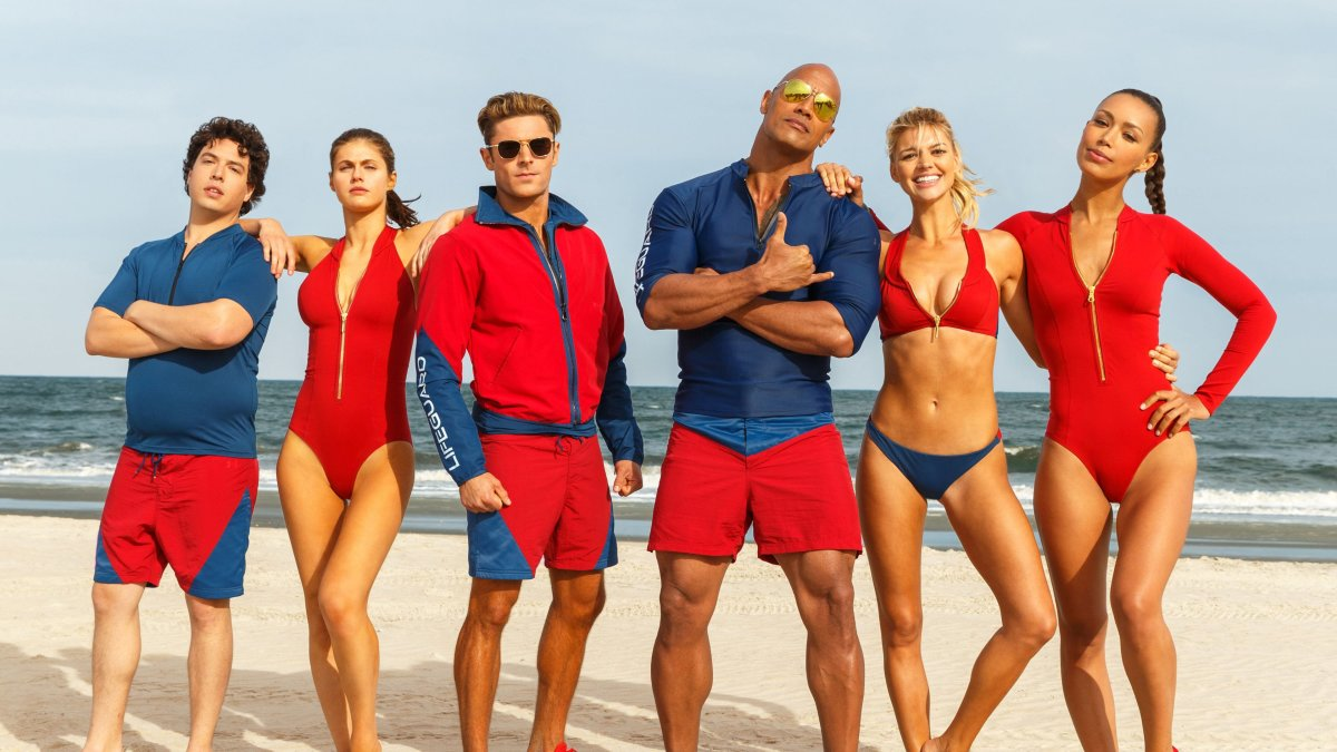 "Jon Bass, Alexandra Daddario, Zac Efron, Dwayne Johnson, Kelly Rohrbach and Ilfenesh Hadera are ""Baywatch."""