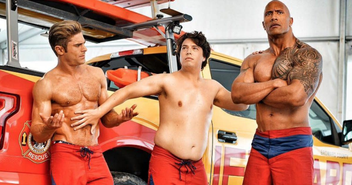 "Zac Efron, Jon Bass, and Dwayne Johnson as Matt Brody, Ronnie Greenbaum, and Mitch Buchannon in ""Baywatch."""