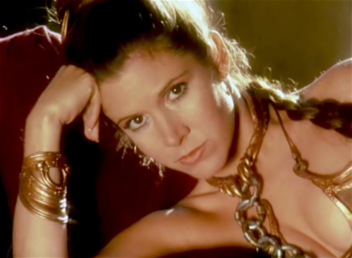 Carrie Fisher, young and beautiful, raised eyebrows (and temperatures) when she wore a metal bikini in Return of the Jedi.