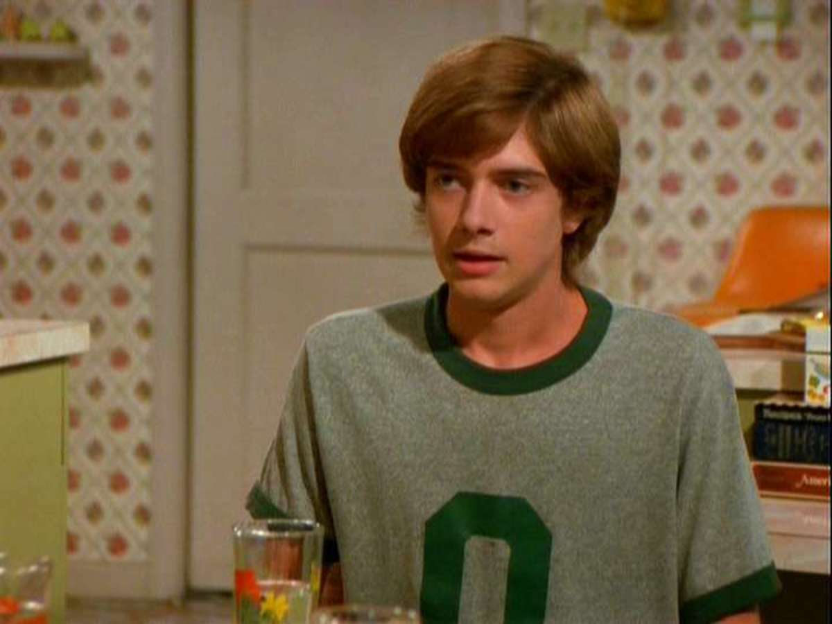 Topher Grace as Eric Forman.