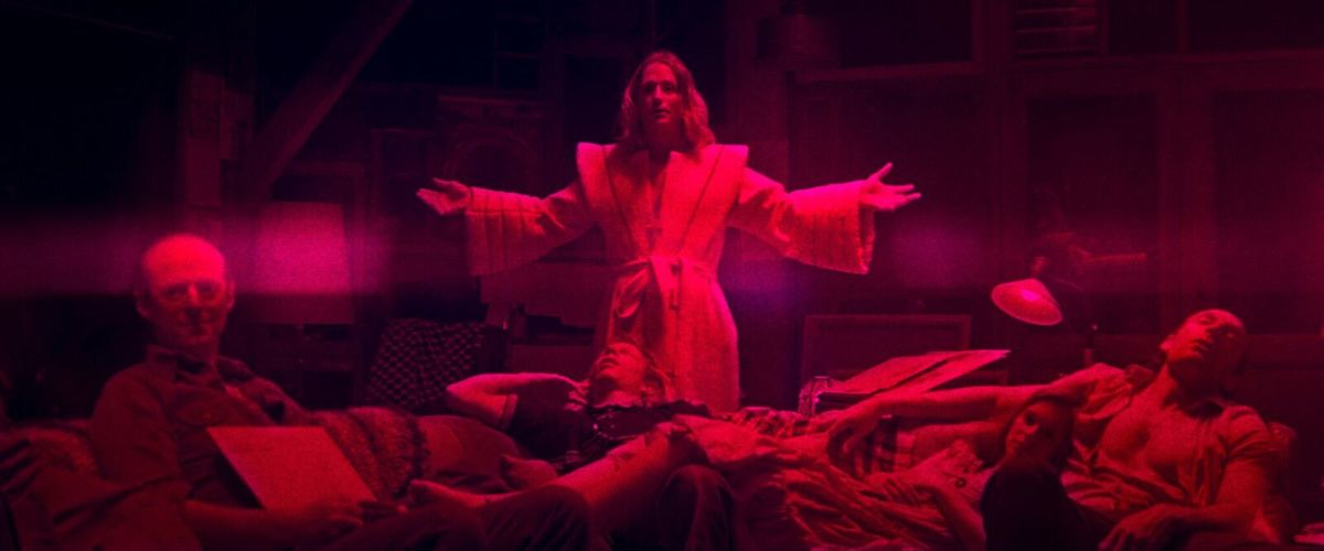 "Jeremiah (Linus Roache) and his Children of the New Dawn in, ""Mandy."""