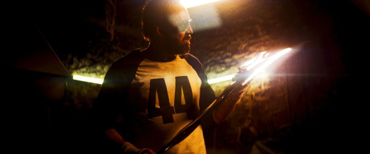 "Red (Nicolas Cage) crafts his own revenge weapon in, ""Mandy."""