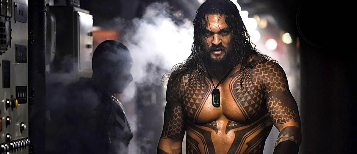 Jason Mamoa emerges from the steam in Aquaman.