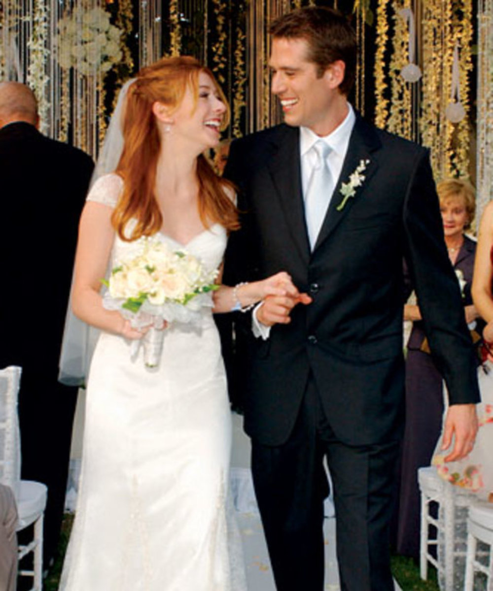From co-stars to lovers; Alyson Hannigan and Alexis Denisof at their wedding in 2003.