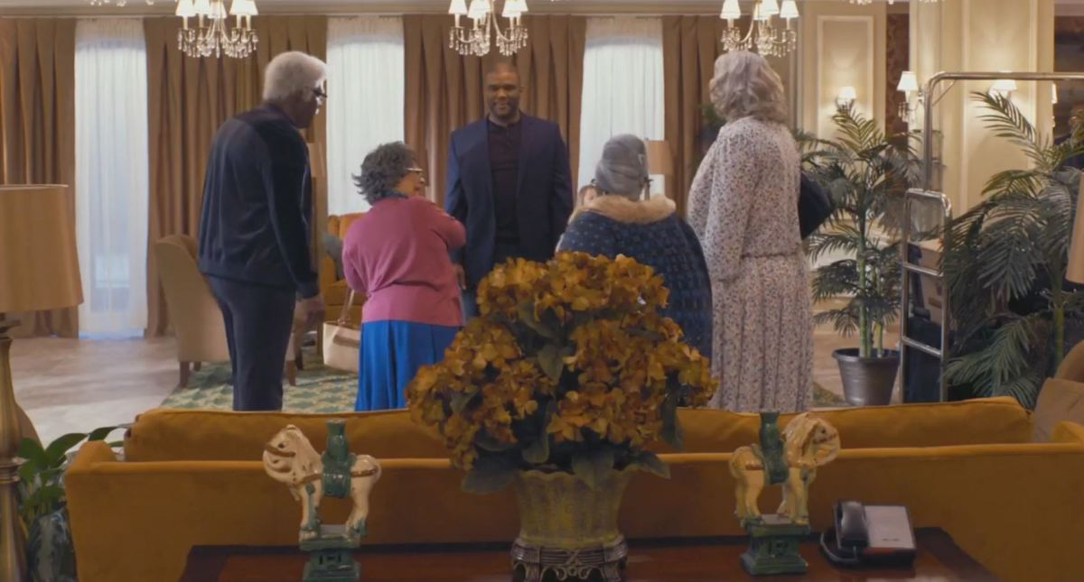 Then Tyler Perry stands and talks.