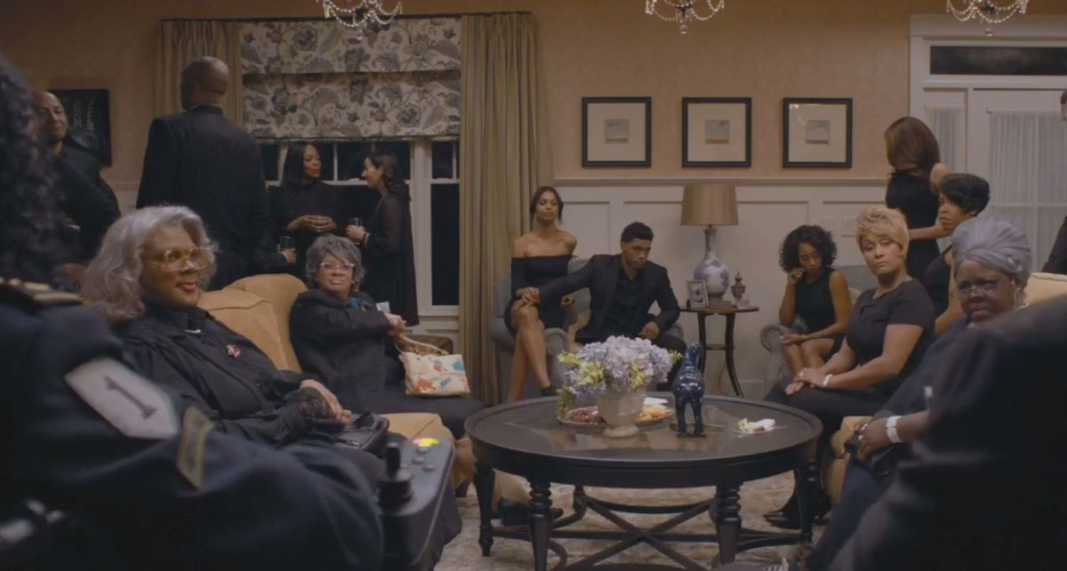 Everyone sitting down because Tyler Perry doesn't like to stand for too long.