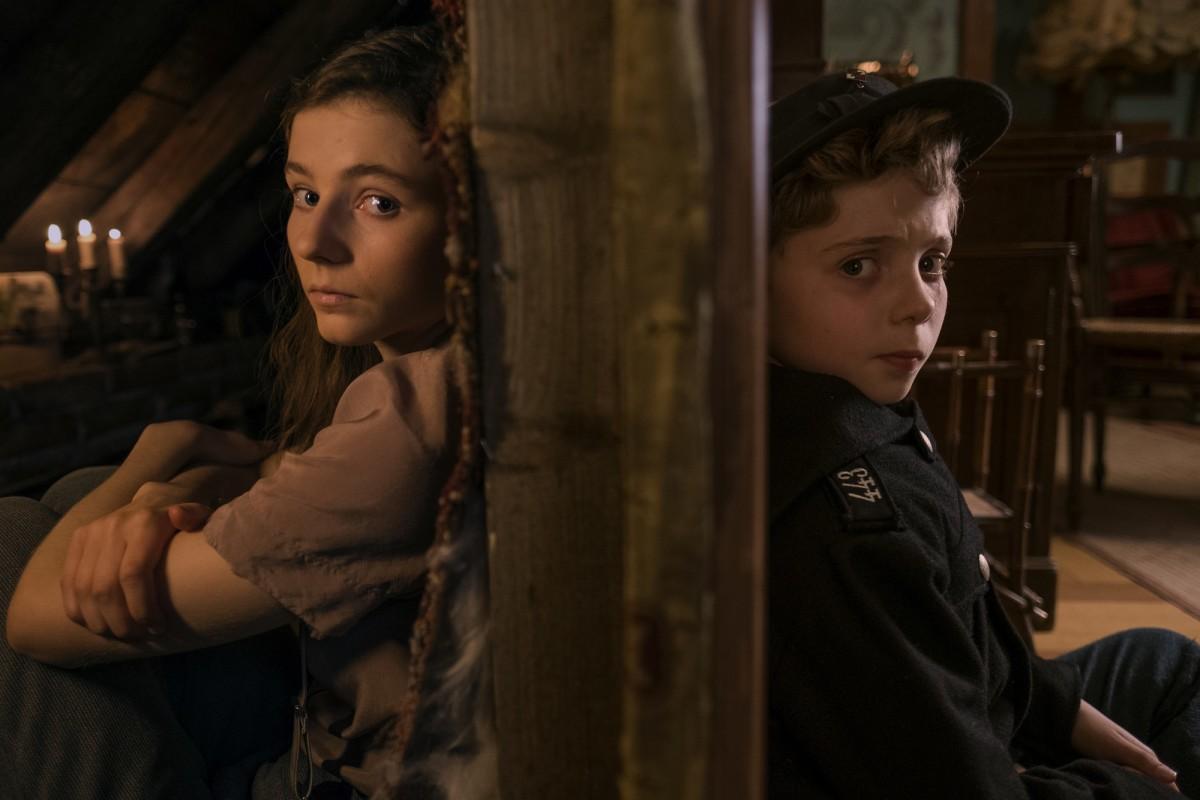 "Thomasin McKenzie and Roman Griffin Davis as Elsa and Jojo in, ""Jojo Rabbit."""