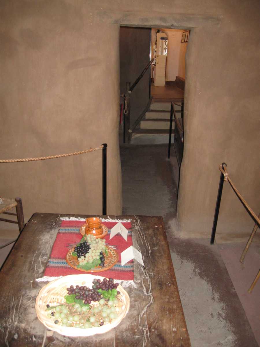 Dinner table with period food inside Santa Fe's Casa Vieja de Analco