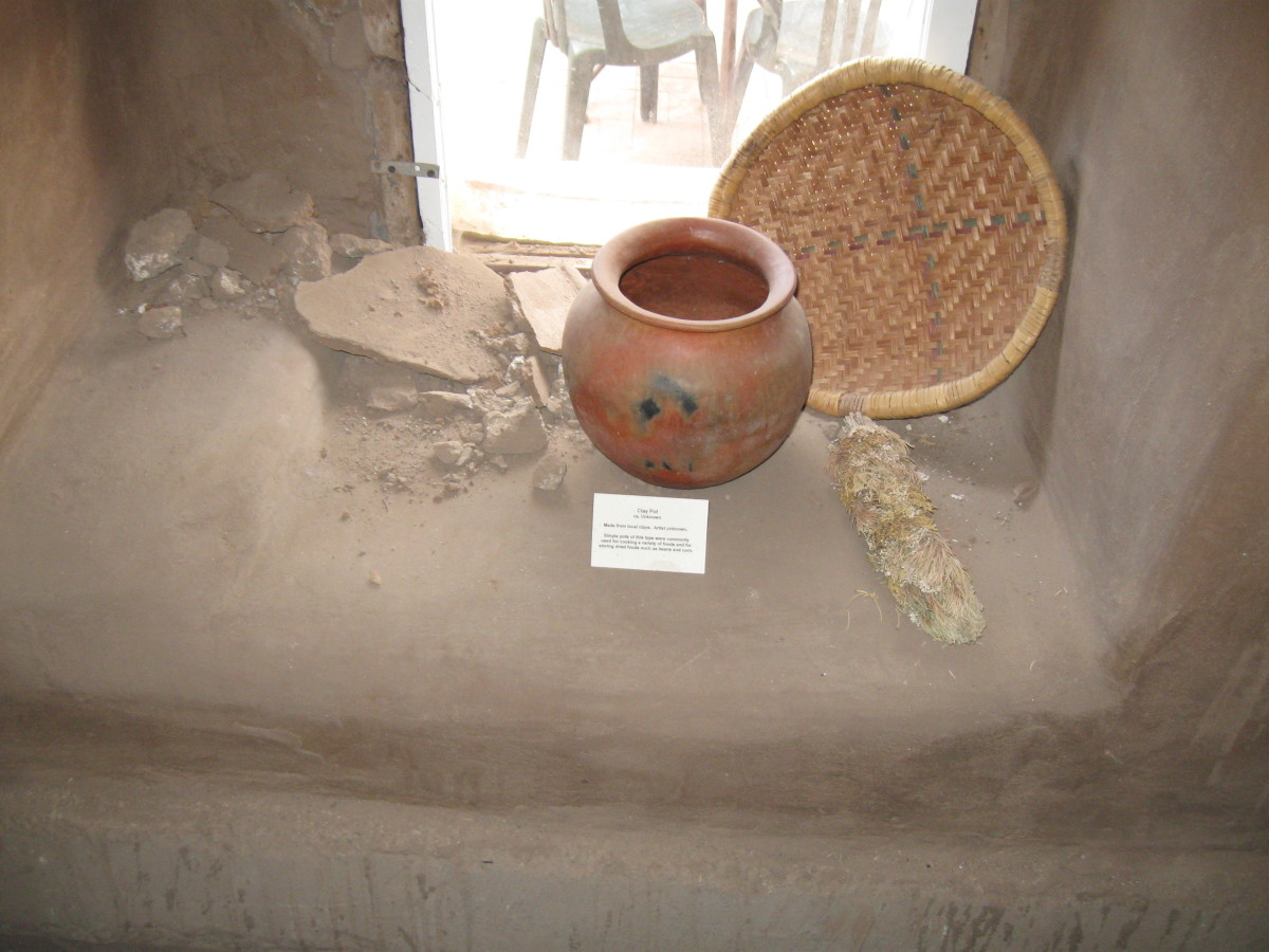 Period Pottery and basket inside Santa Fe's Casa Vieja de Analco