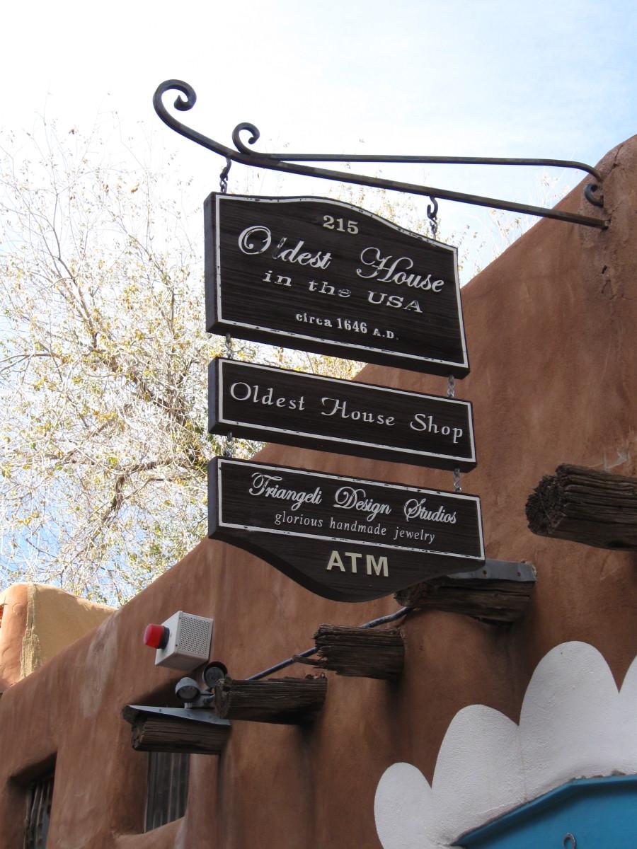 Sign over Entrance to Santa Fe's Casa Vieja de Analco