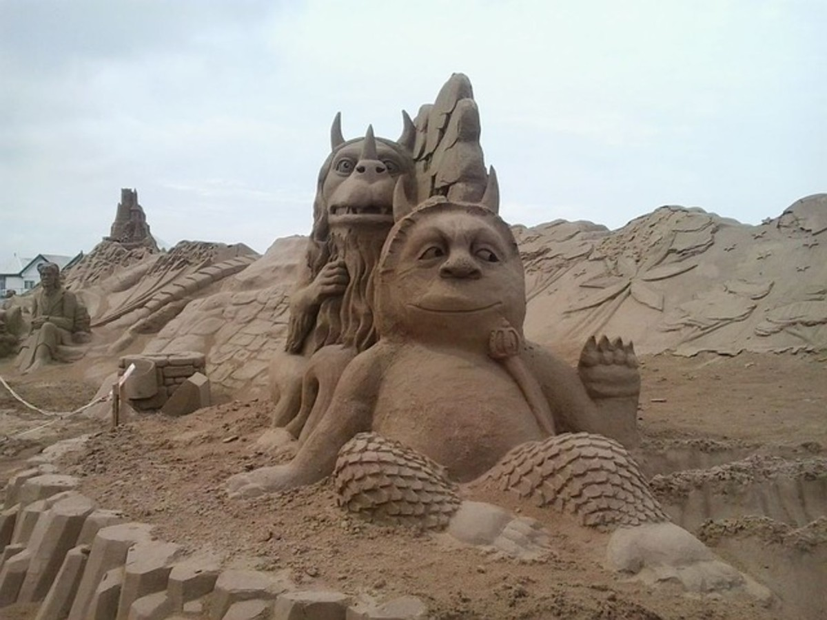 "Building a sandcastle is a great way to spend your time on the beach. Try to get really creative with your ""castle""!"
