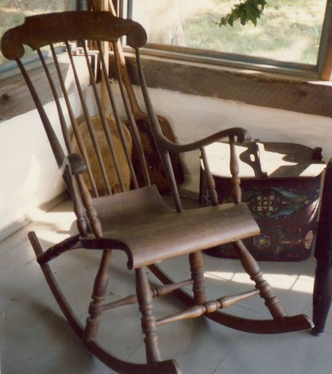 A carved three legged rocker at Little Norway