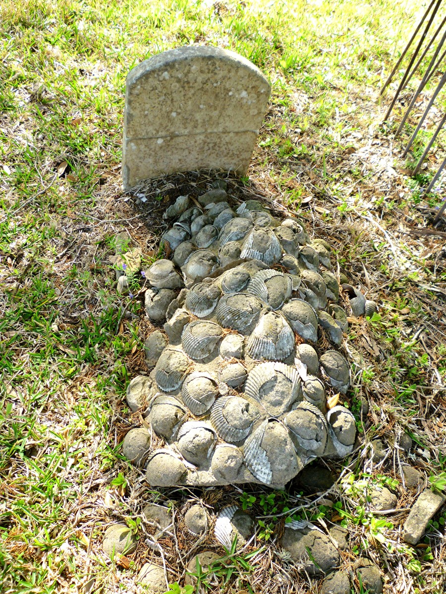 Very old grave embellished with shells in the Masonic Cemetery in Chappell Hill, Texas.