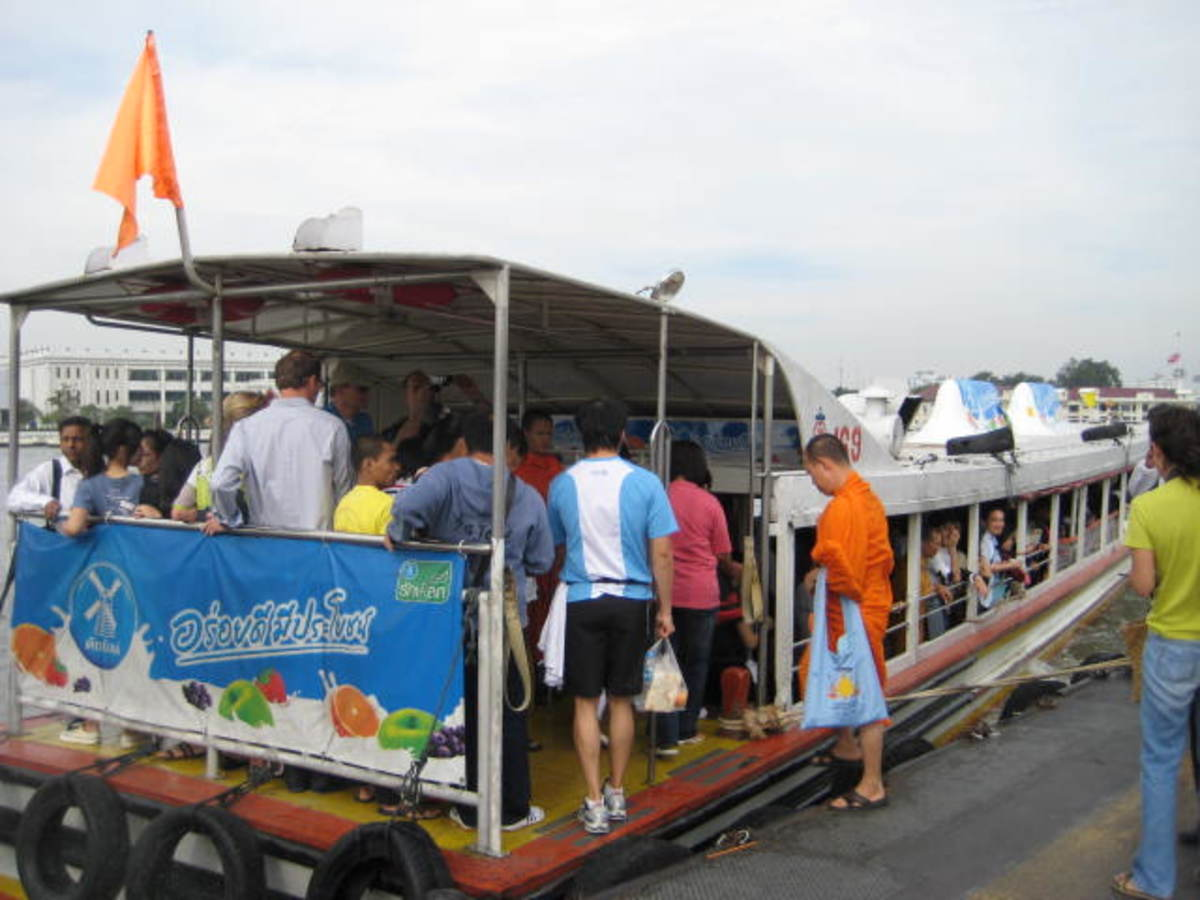Bangkok Express River Boat has an orange flag. Fares are very cheap.