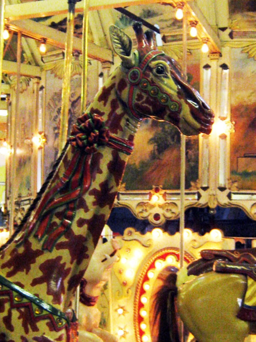 Giraffe on the old carousel