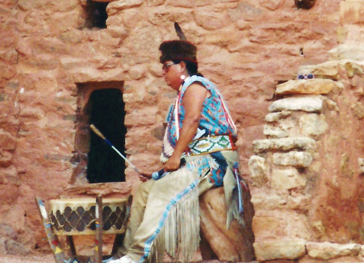 Indian beating the drum and chanting for the Indian dancers at the Manitou Cliff Dwellings.