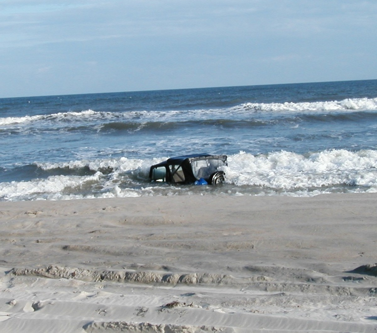 Jeep stuck in sand as tide comes in on Ocracoke Island,  NC.