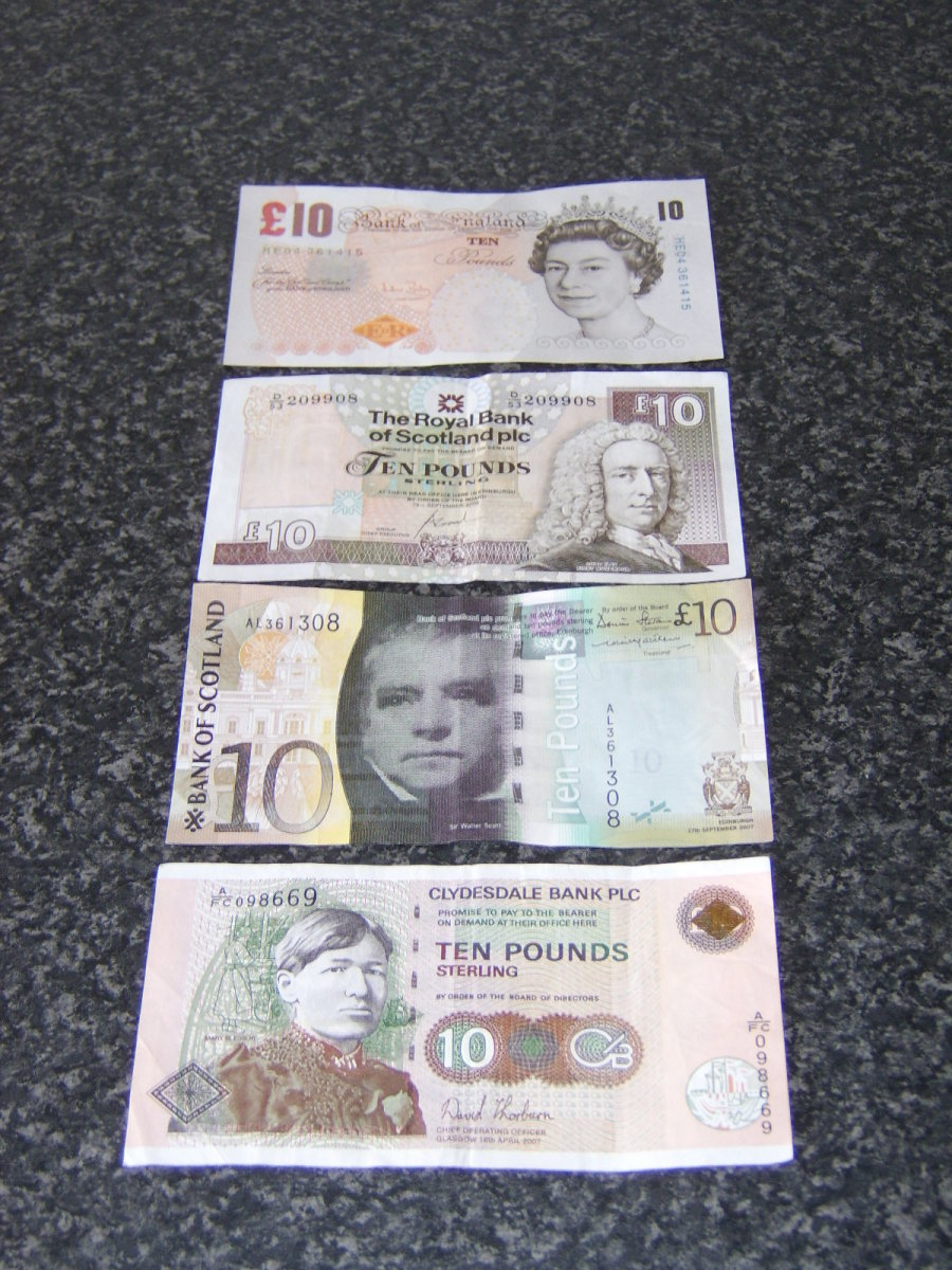 Examples of the different notes you will encounter in Scotland on a daily basis. These are all 10 pound notes and are issued by (from top to bottom) Bank of England, Royal Bank of Scotland, Bank of Scotland and Clydesdale Bank
