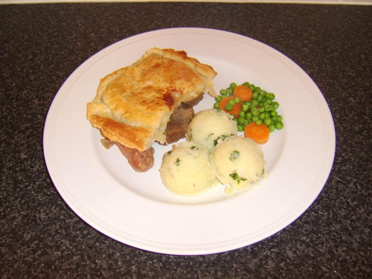 Scottish Steak Pie with Mashed Potatoes, Carrots and Peas