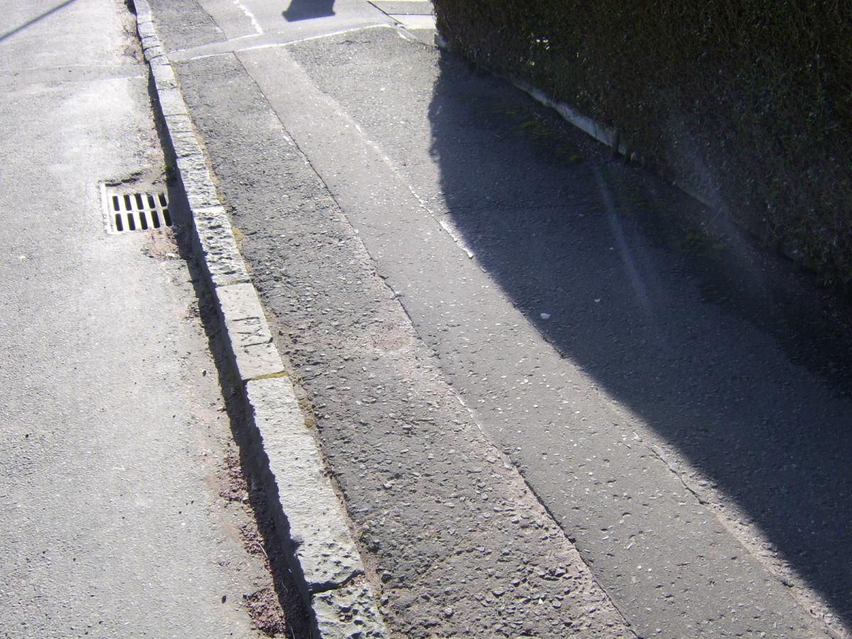 Sidewalk in the USA - pavement in Scotland
