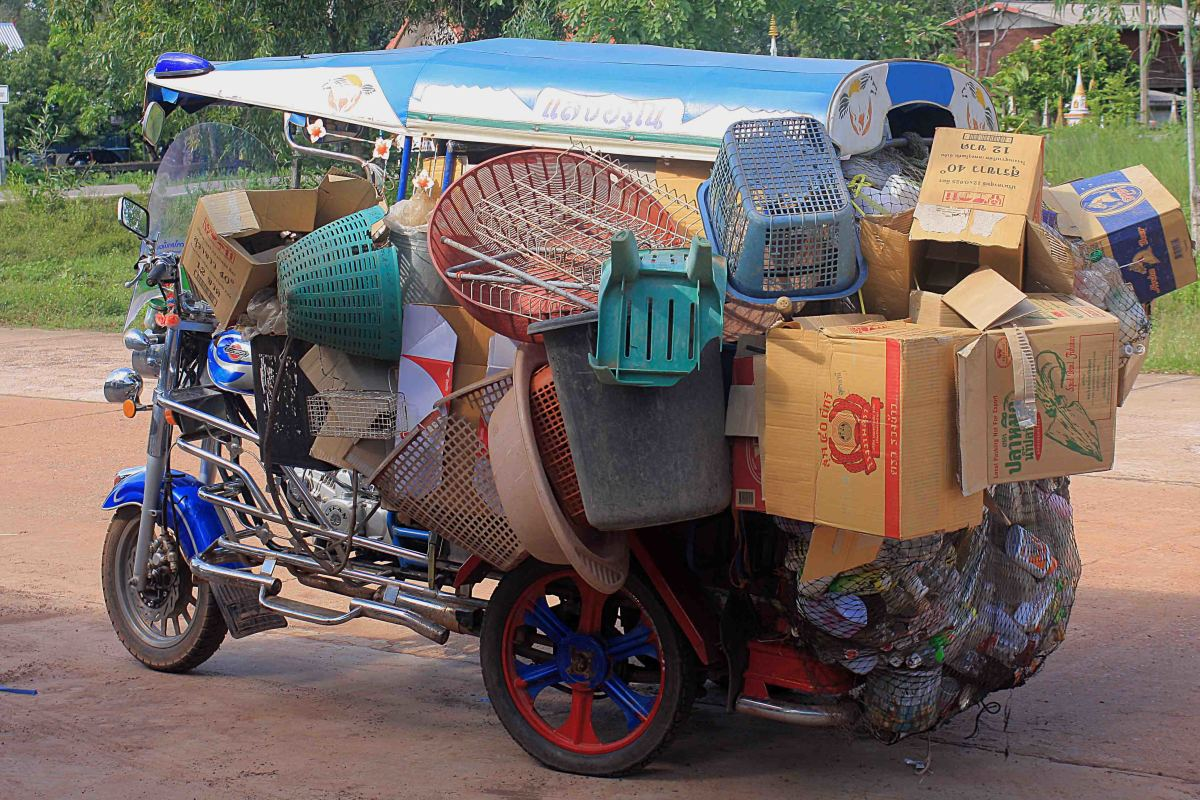 In the cities, the motorised tricycle known as a tuk-tuk is used as a taxi, but in the villages it may be used for transporting goods ...