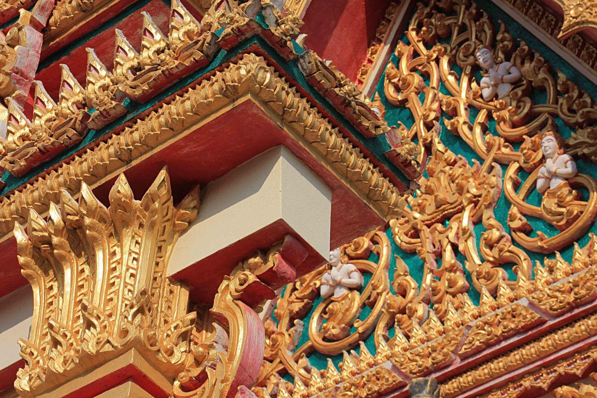 The gaudy gold, red and green ornamentation of the local Buddhist temple