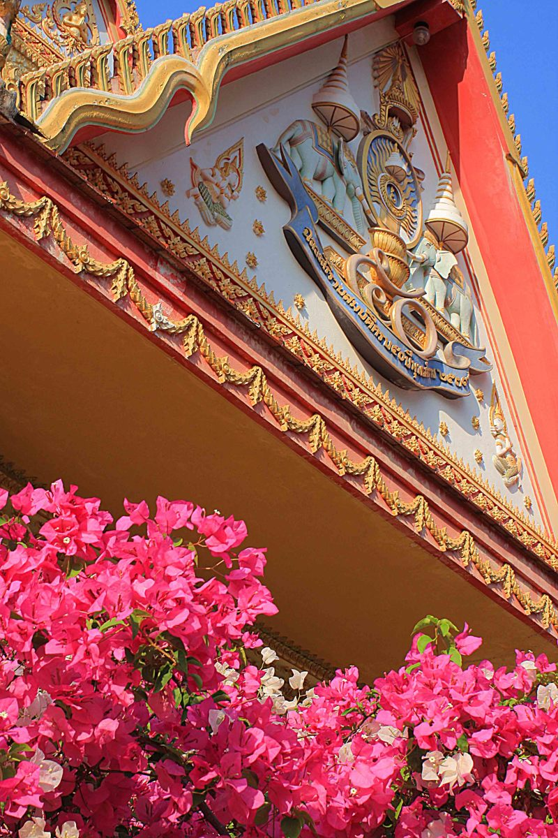 Temple decoration and a colourful display of red-pink Bougainvillea