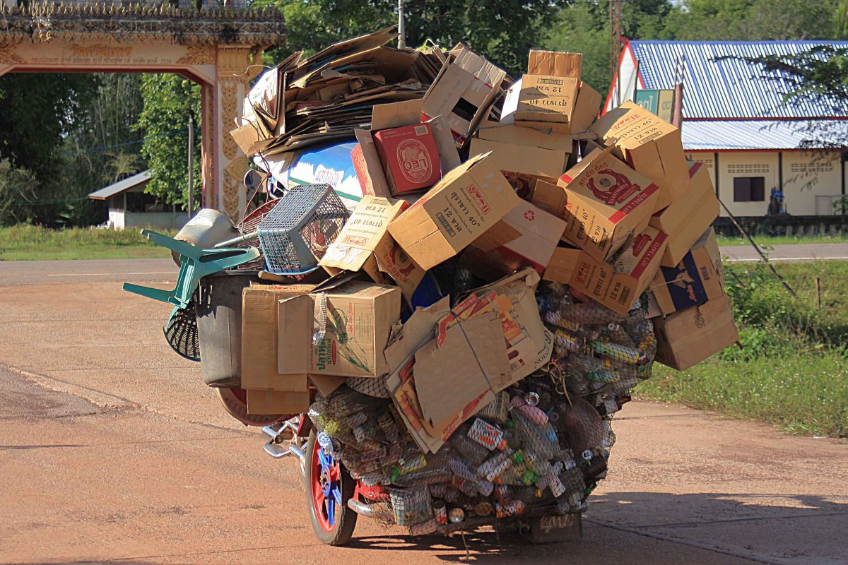 ... An awful lot of goods! This guy collected junk. Not sure what he did with all the old junk. Maybe he recycled it, or just sold it for scrap? But click to blow the image up for more detail - see it to believe it!