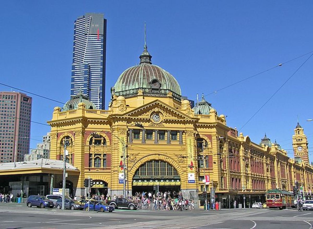 Historic Flinders Street Station, Australia's first railway station, with the Eureka Tower skyscraper in the background.