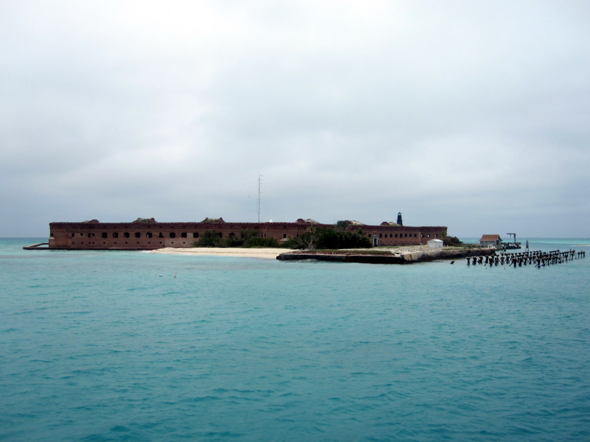 Fort Jefferson rises into view from an expanse of blue water as the ferry approaches
