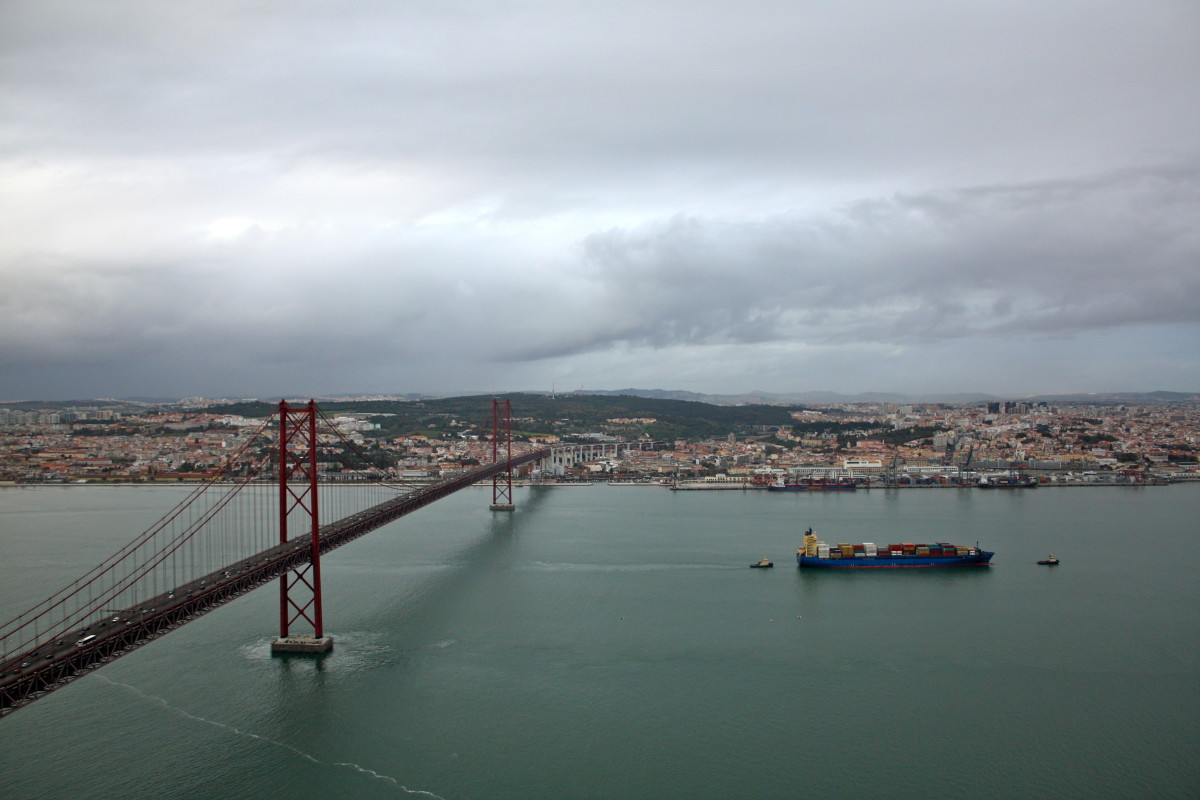Lisbon and the 25 de Abril Bridge whose reddish tint remind me of the Golden Gate