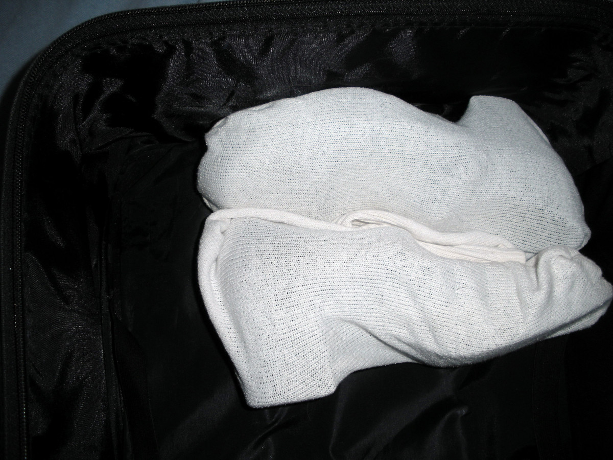 """Bagged"" shoes in position in suitcase"