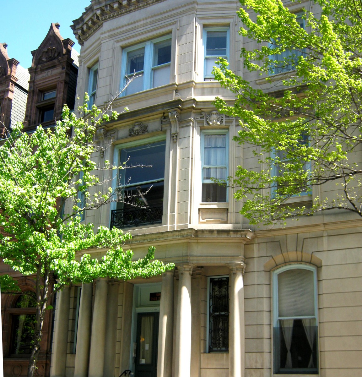 Bowed front row house with columns