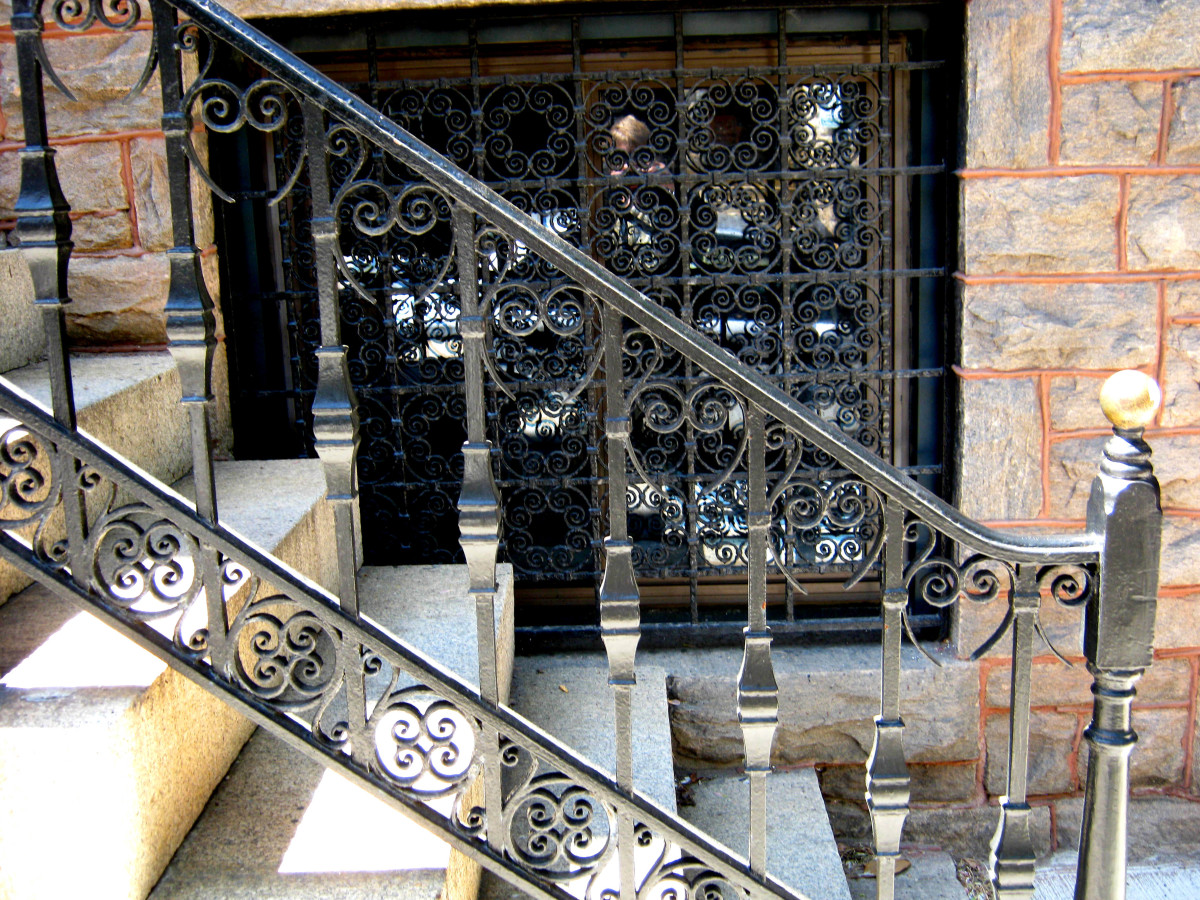 Cast iron stair rails and window cover