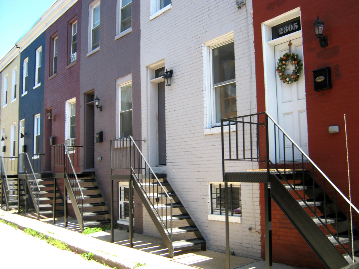 These simple two bay homes are on a very narrow street, once an alley.