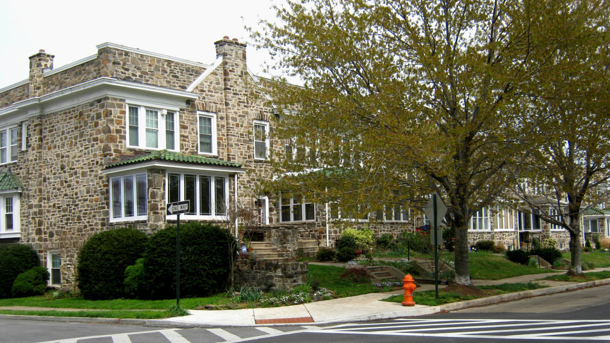 All stone rowhouses with slate roof and sun porch.