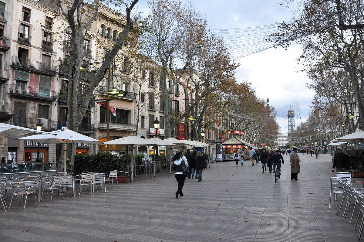 La Rambla is a street in central Barcelona, popular with both tourists and locals alike. A 1.2 kilometer-long tree-lined pedestrian mall in the Barri Gtic, it connects Plaa Catalunya in the center with the Christopher Columbus monument at Port Vell.