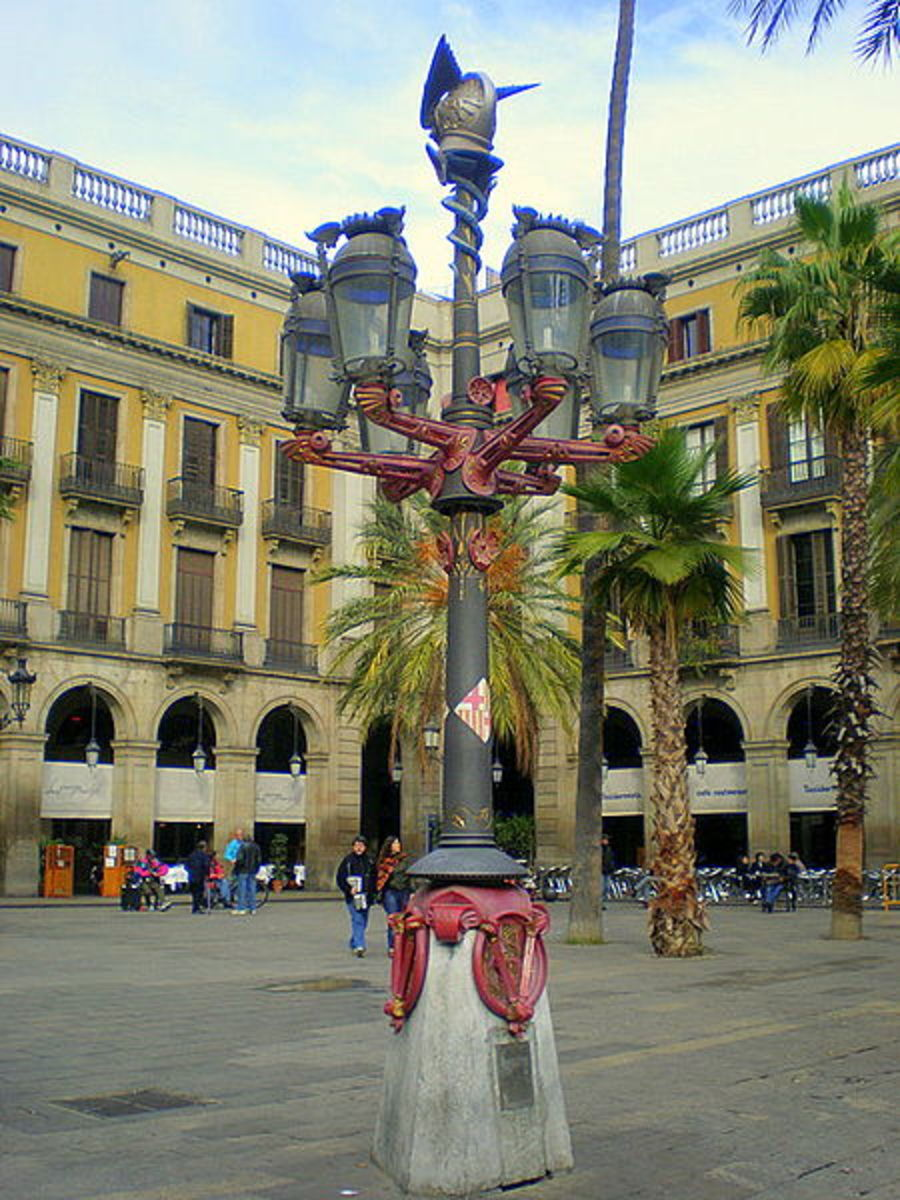 Placa Reial...Many identical buildings in this area on the site of a former Capuchin convent.  Many motifs showing explorers of the New World.  Many bars and markets in this area.
