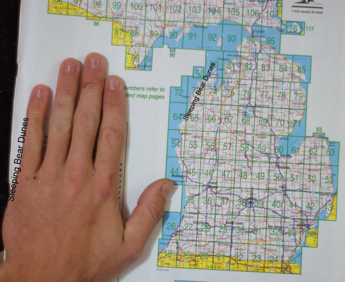 Michigan looks like a hand, including thumb and little finger.  Sleeping Bear Dunes is on the western shoreline of the Little Finger.