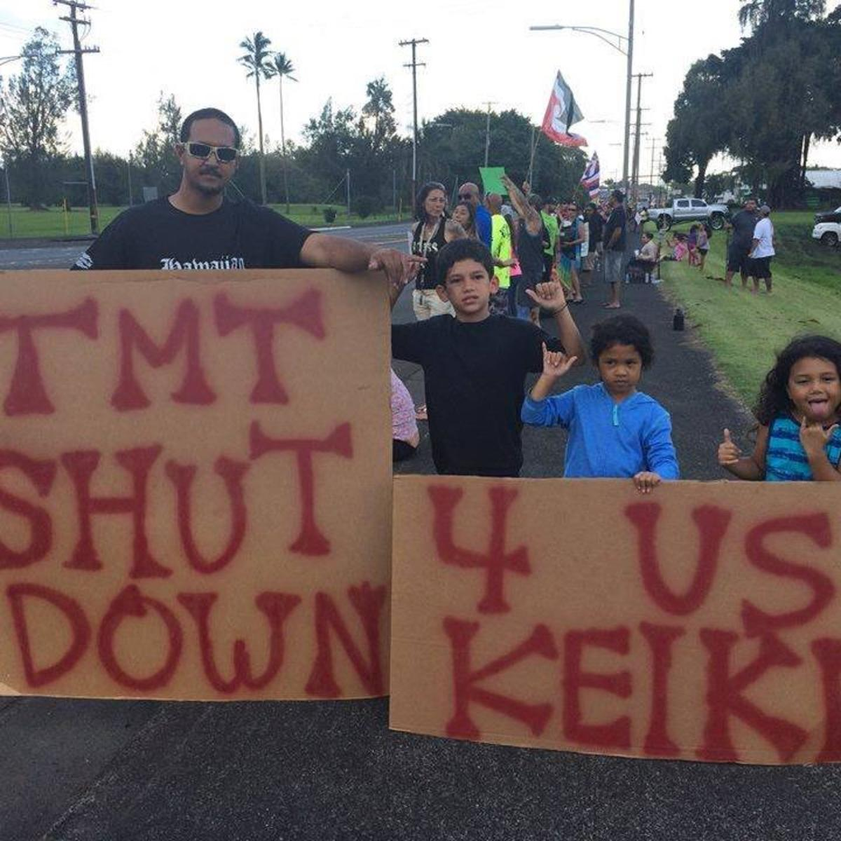 A family protesting construction of the thirty-meter telescope on Mauna Kea's summit.