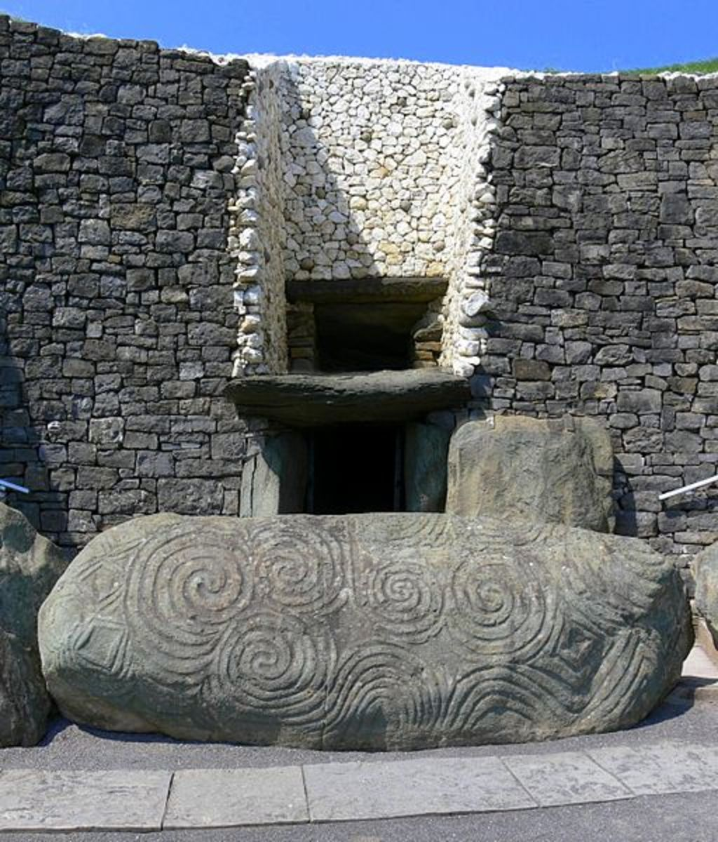 Stone with Celtic art engravings at entrance to megalith tomb at Newgrange
