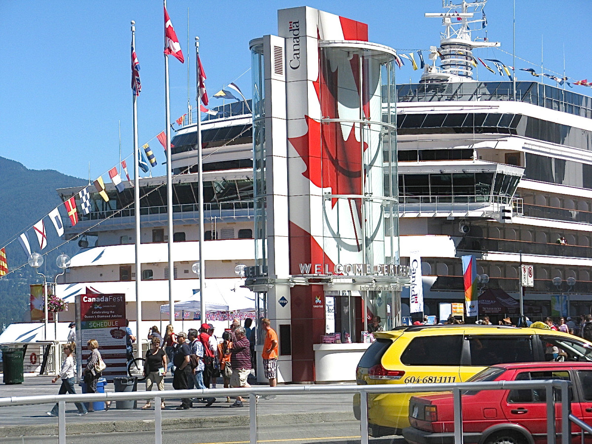 Canada Place entrance with a cruise ship; the building with the large maple leaf is the welcome centre