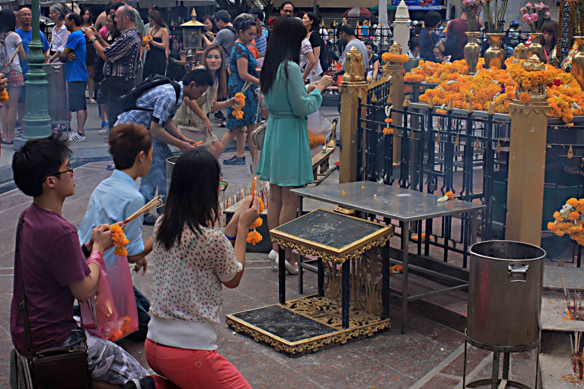 The drawing power of this tiny shrine is apparent as Thais come from the shops and offices around to pray and to make offerings
