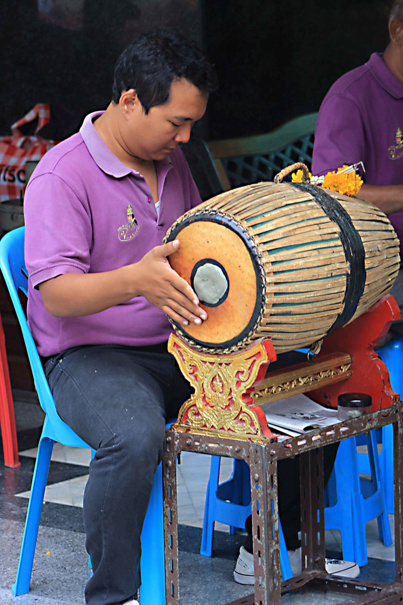 One of the musicians at the shrine plays in accompaniment of the dancers