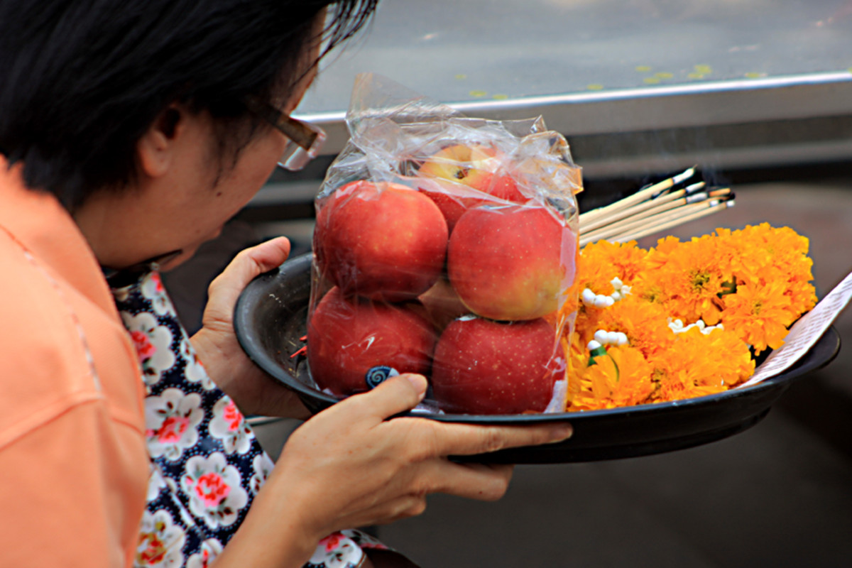 Offerings of fruit and flowers with incense