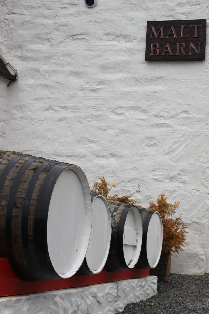 Decorative whisky barrels at Edradour's Malt Barn entrance