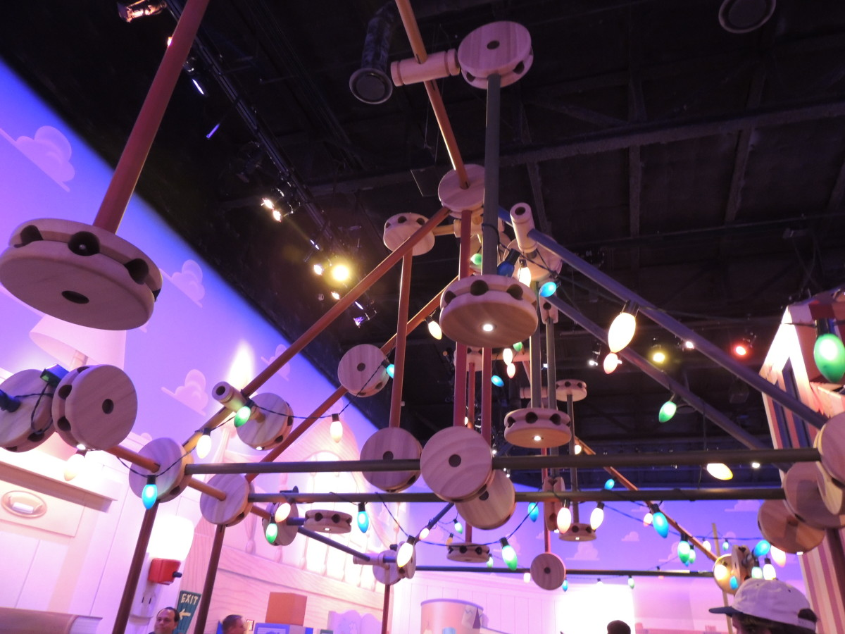 Tinker Toys suspended above the line to the Toy Story Midway Mania Ride