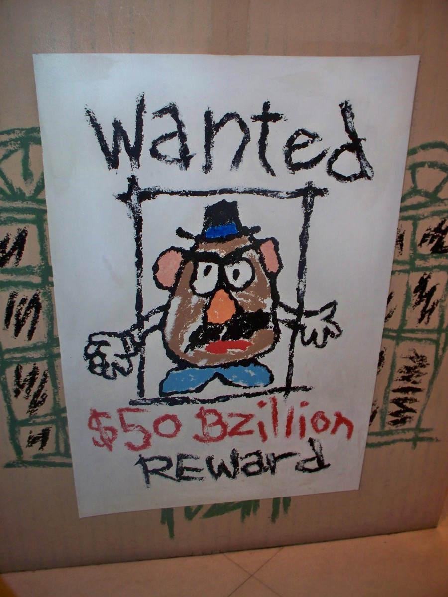 Mr. Potato Head wanted sign located on the way into the Toy Story Midway Mania Ride
