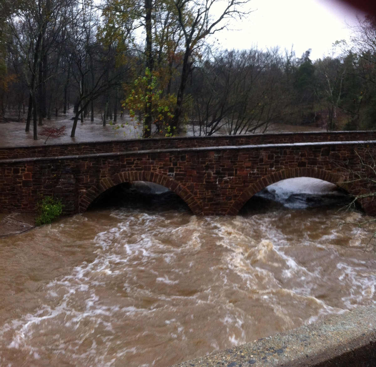 Late in 2012, a powerful storm hit Northern Virginia.  Unlike most people, who hunkered down in their homes, we went to see what the tremendous rain did to Stone Bridge.  Forgive the quality.  This shot was taken with the iPhone.