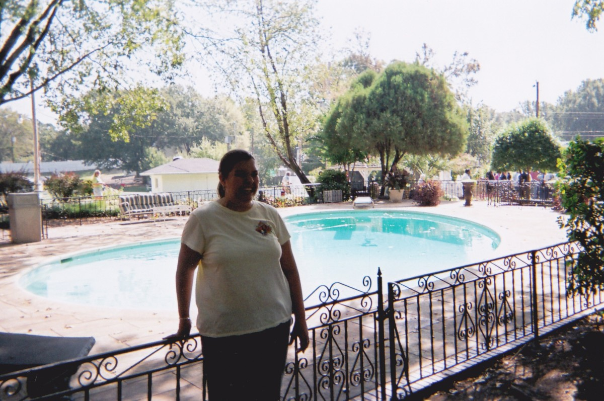 Me at Graceland standing next to Elvis' pool.